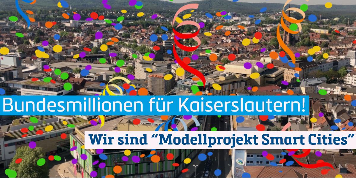 """Stadtansicht von Kaiserslautern mit einem Konfettiregen. Schriftzug: Bundesmillionen für Kaiserlautern - Wir sind """"Modellprojekt Smart Cities """""""